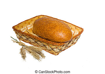 loaf in a basket with ears of wheat isolated