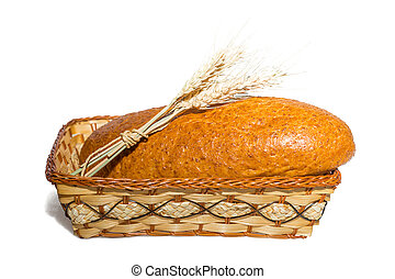 loaf in a basket with ears of wheat on a white background