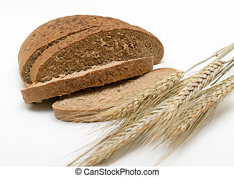 loaf of black bread and ears of wheat on a white background