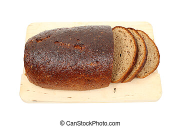 Loaf of bread on a cutting board isolated over white background