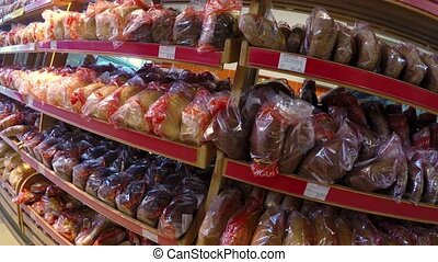 loaf of bread on shelves in a supermarket store market...