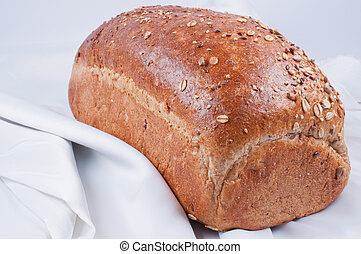 loaf of bread on white linen