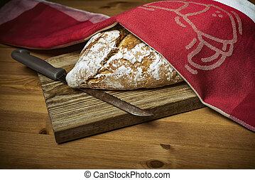 Loaf of bread on wooden board