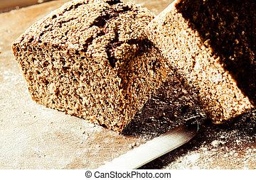 Loaf of freshly baked wholegrain brown bread