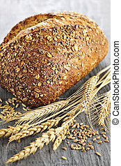 Loaf of multigrain bread - Loaf of fresh baked multigrain...
