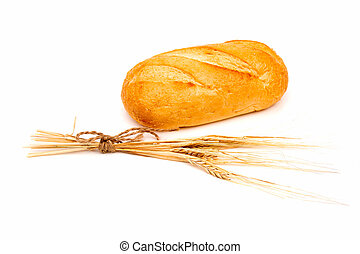 Loaf of rye bread or baguette with ear of wheat on white background