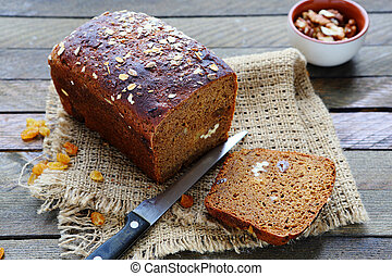 loaf of rye bread with nuts and raisins