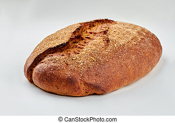 Loaf of traditional bread on white background.