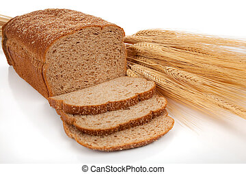 Loaf of wheat bread and shocks of wheat - A loaf of wheat...