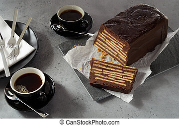Loaf-shaped chocolate biscuit cake and coffee