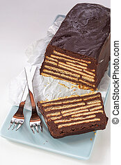 Loaf-shaped chocolate cake with biscuits