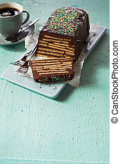 Loaf-shaped chocolate cake with topping
