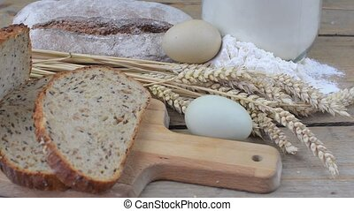 Loafs of bread, slices of bread, wheat flour, eggs and ears...