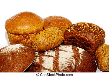 loafs of whole wheat and rye bread and isolated