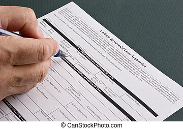 Man filling out a residential home loan application