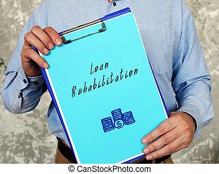 Loan Rehabilitation phrase on the sheet.