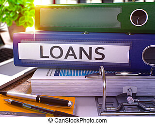 Loans on Blue Ring Binder. Blurred, Toned Image.