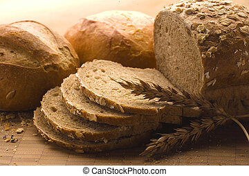 Loaves of baked bread - Various sized loaves of baked and...