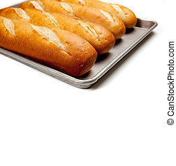 Loaves of french bread on a baking sheet