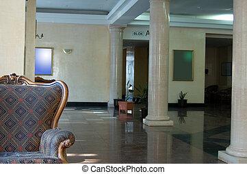Lobby - Shot of hotel interior of lobby, focus on armchair