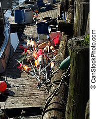 Lobster bouys - A working lobster boat along the dock in ...