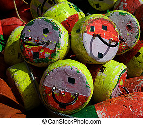 Lobster Bouys - An assortment of lobster buoys is arranged ...