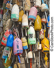 Lobster buoys nailed to a fishing shack wall in Maine, USA