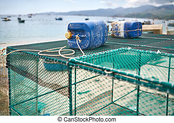 Lobster netting cages on sand beach in Vietnam