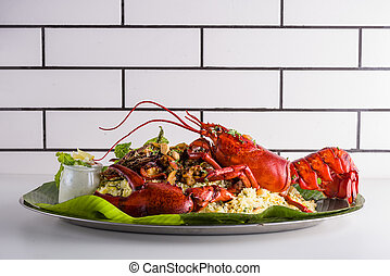Lobster on a plate, side view with salad leaf, seafood with rice.