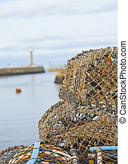 Lobster pots on a harbor quayside - Closeup detail of ...