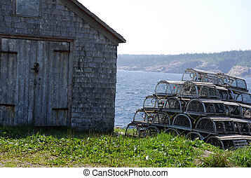 Lobster Pots Stack and Shack - A tall stack of lobster pots ...