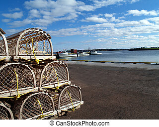 Lobster Traps on the Wharf with Cop - Lobster traps stacked ...