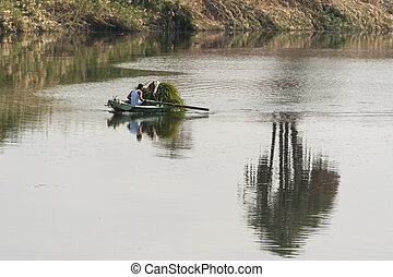 Local egyptian nubian in a boat