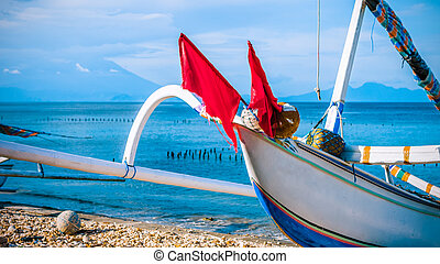 Local Fisherboat with view to St. Agung Vulcano on Bali from...