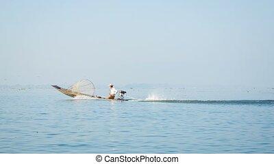 local fisherman on fishing boat with a motor. Inle lake, Burma (Myanmar)