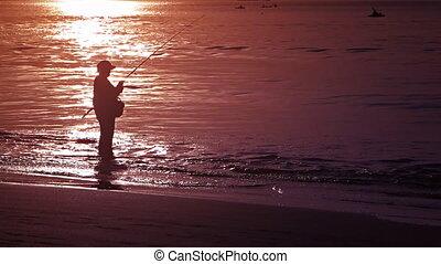 Local fisherman on the sandy beach during sunset - PHUKET,...