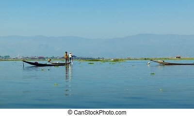 Local fishermen on a background of mountains. Burma, Inle...