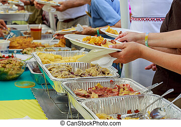 local food culinary sold at street market - A buffet on a...