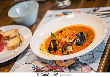 Local food Kiev - Seafood soup with tomatoes at local...