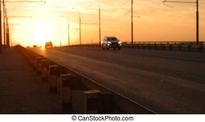 Highway overpass slow motion blurred with orange sunset...