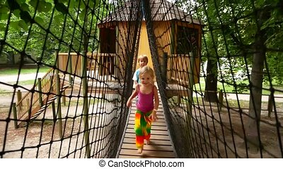 Local kids run and play on the suspension bridge. Games on...