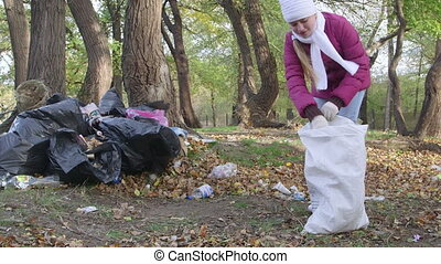 local residents cleaning park from garbage after holiday...