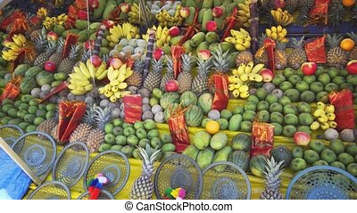 Variety of colorful fruits on display, for sale as religious offerings outside a temple in Kataragama, Sri Lanka.