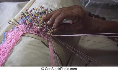 Local Woman Weaving Lace in Sri Lanka. - Local woman weaves...