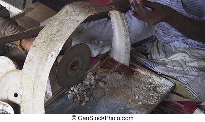 Local Worker Grinding Moonstones in Sri Lanka - Local worker...