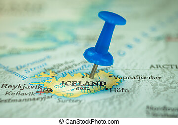 Location Iceland, push pin on map close-up, marker of destination for travel, tourism and trip concept, Europe