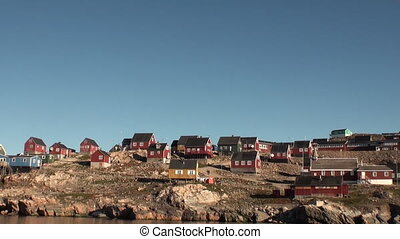 Location in the mountains on the shores of of Greenland Arctic Ocean.