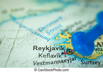 Location Reykjavik in Iceland, push pin on map close-up, marker of destination for travel, tourism and trip concept, Europe