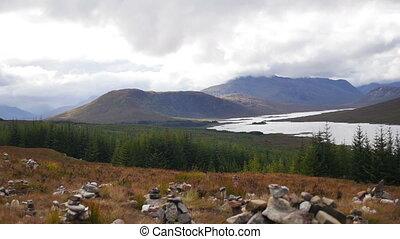 Loch Ness in the Scottish Highlands - Inukshuks along the...