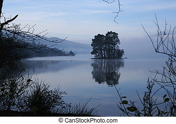 loch tay morning - Small tree-covered island rises out of...